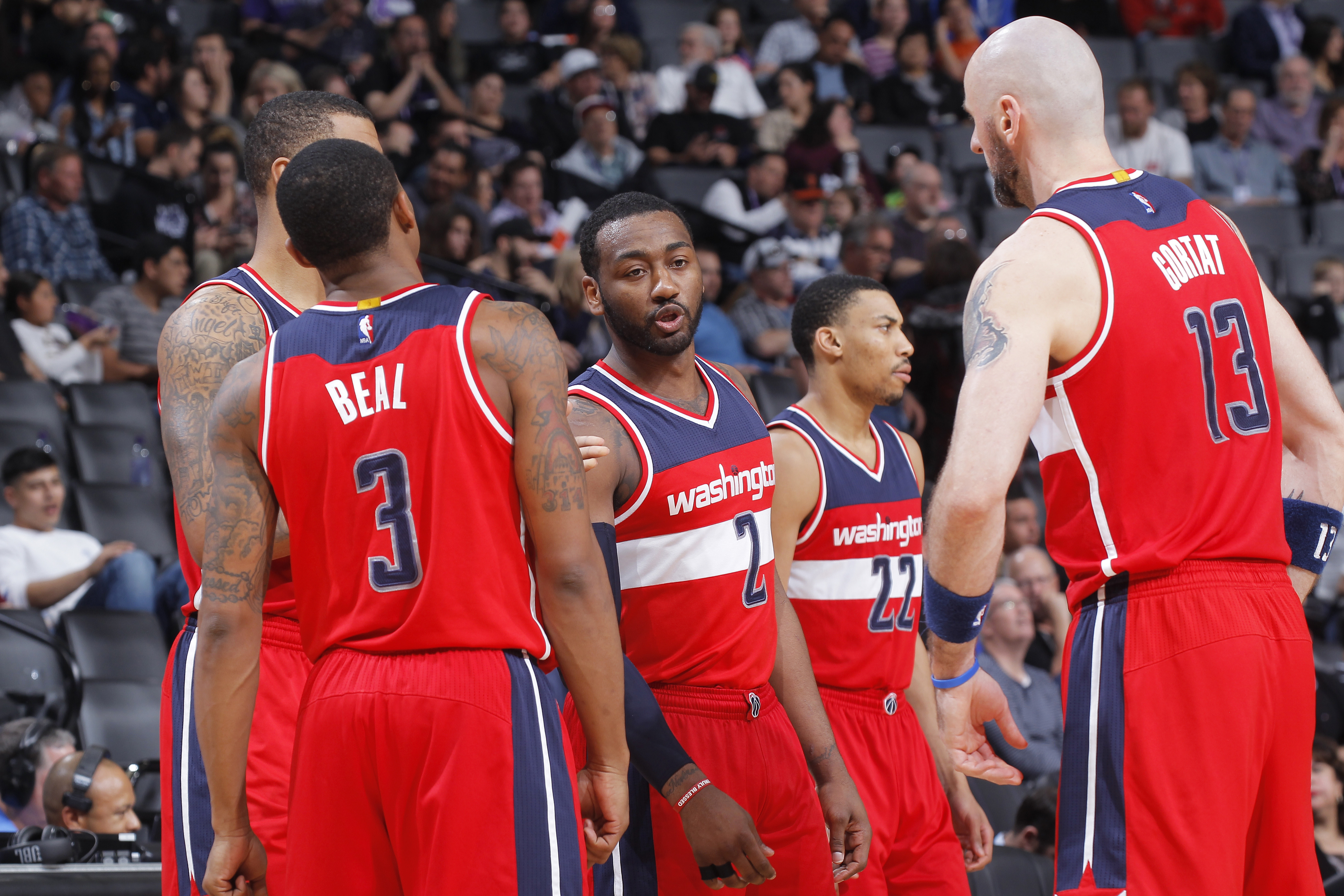 sacramento ca march 10 bradley beal 3 john wall 2 otto porter 22 and marcin gortat 13 of the washington wizards huddle up during the game against